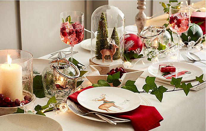 Table laid with Christmas crockery and decorations