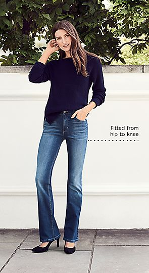 Model wears slim boot jeans