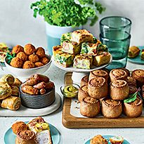 Platter of pork pies, quiche, sausages and Scotch eggs