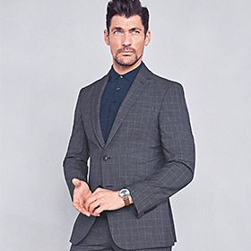 Man wearing grey work suit