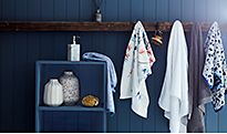 Plain and patterned towels hanging in bathroom