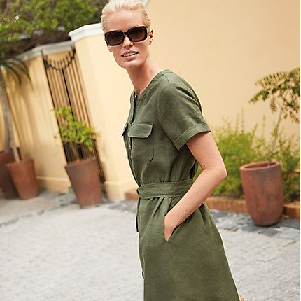Woman wearing black sunglasses and a khaki linen dress