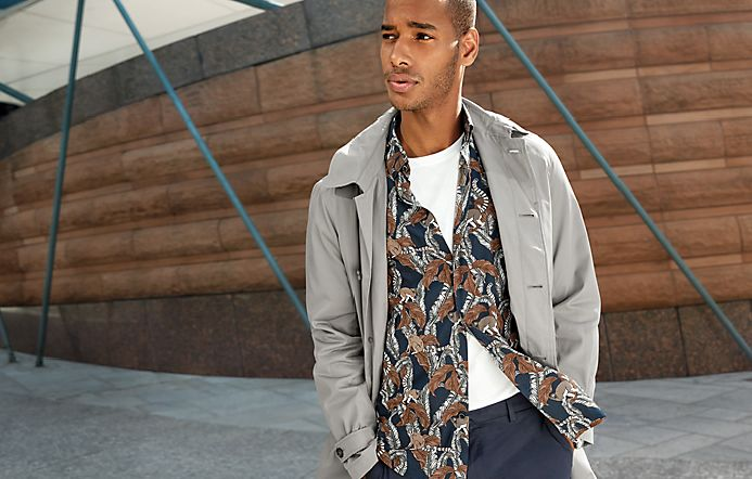 Man in patterned shirt and our Must-Have trench coat