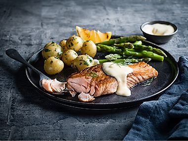 Pan-fried salmon with asparagus and Jersey royals