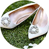 Pair of white embellished bridal shoes