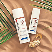 Ultrasun sun creams in the sand