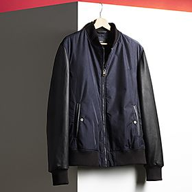 Men's leather-sleeved black bomber jacket