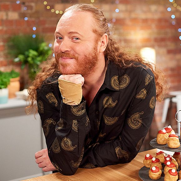 Keith Lemon poses in the M&S Food tasting kitchen with Santa hat profiteroles
