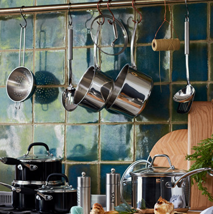 Kitchen kitted out with pots and pans, utensils and chopping boards from the M&S cookware range