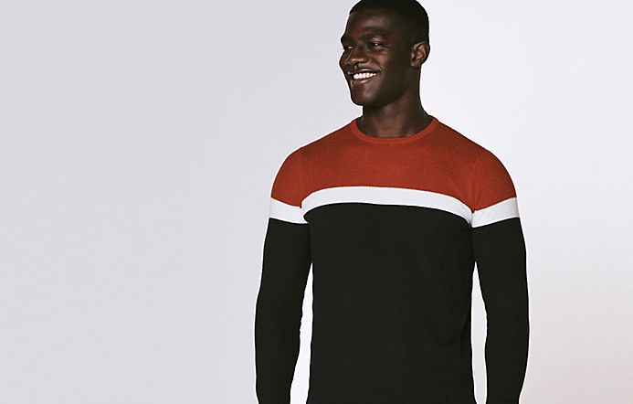 Man wearing colour-block jumper