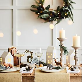 Christmas decorations and candles on a table
