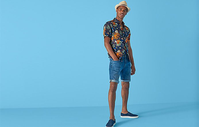 Man wearing octopus-print shirts and denim shorts