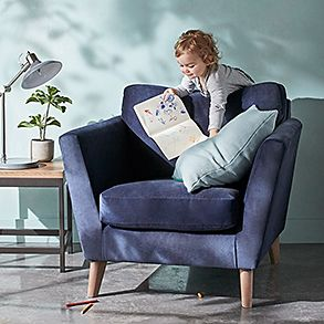 Armchair with child playing