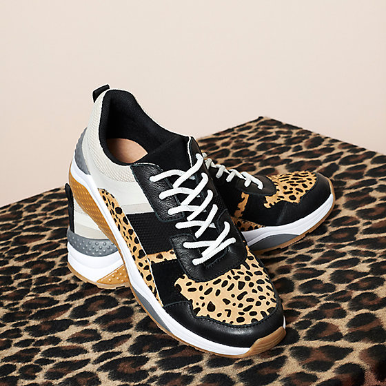 bc02774425a65 Leopard-print trainers against an animal-print background
