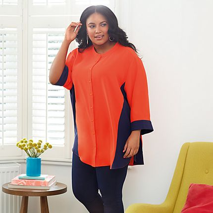 Model wearing a colour-block orange and navy blouse from the Curve collection