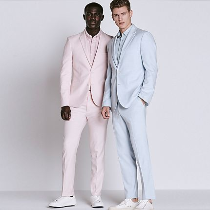 Men wearing light blue and light pink skinny-fit suits