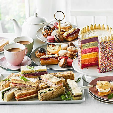 A selection of cakes, sandwiches and party food