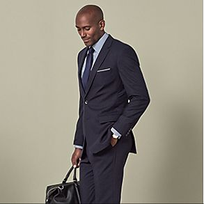 Man wearing grey suit