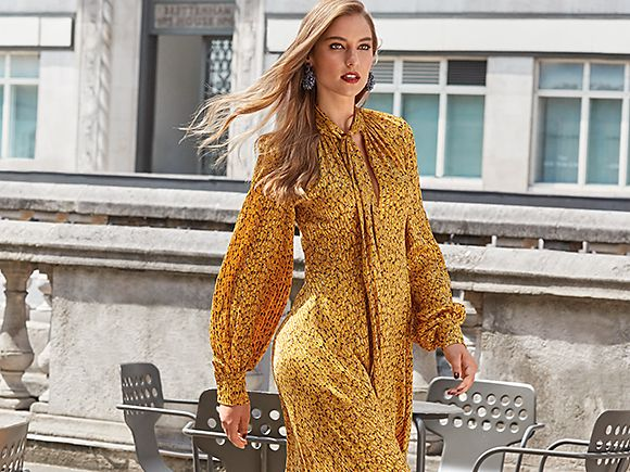 Woman wearing a yellow animal-print midi dress