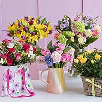 A selection of colourful Mother's Day blooms and planters
