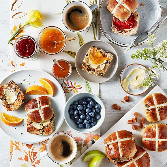 Luxury hot cross buns served with a range of sweet toppings