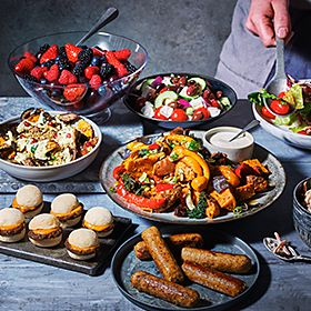 BBQ food including sausages and mini burgers