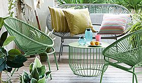 Green garden furniture on decking