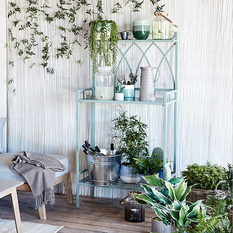 Rosedale metal garden shelving with drinks and potted plants