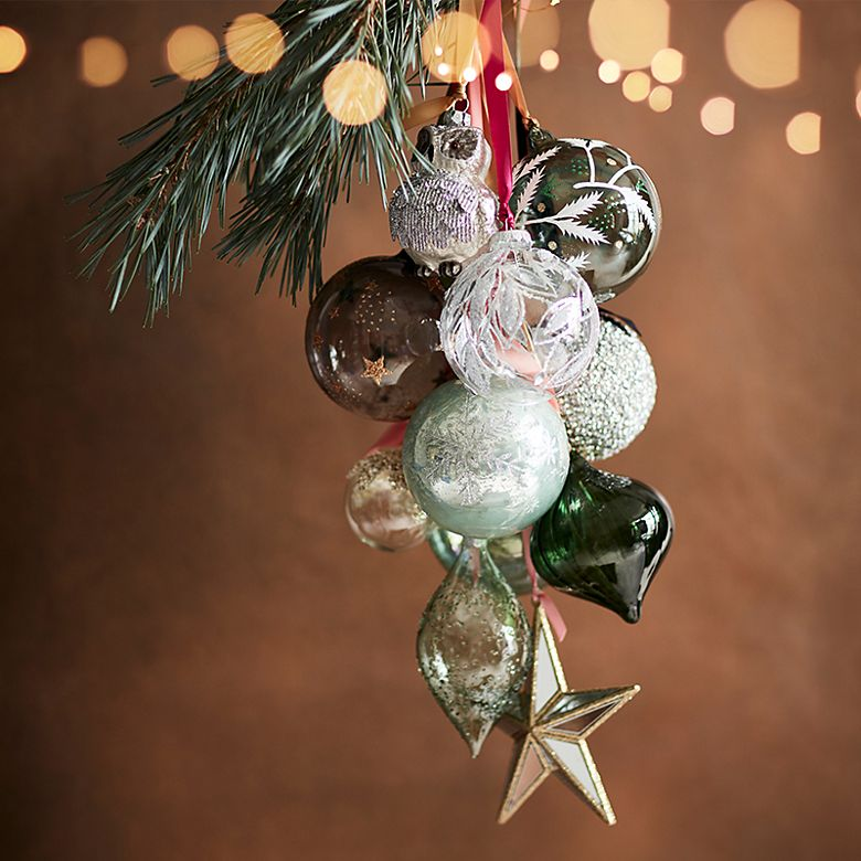 Cluster of baubles hanging from a Christmas tree branch
